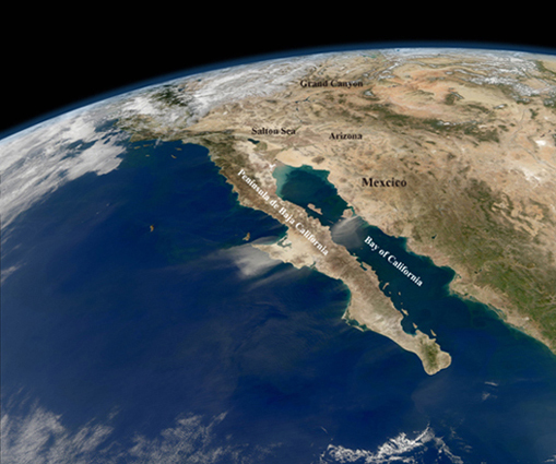 Mostly cloud-free skies and a compelling view of the entire length of Baja California and the Pacific coast of Mexico. In the midst of the clarity, strong northeasterly winds stirred up dust storms on the mainland and the peninsula. ©NASA GSFC.