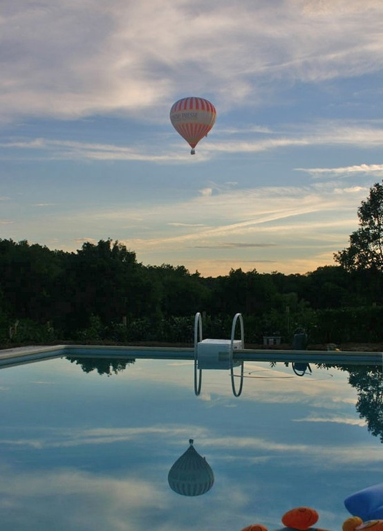 hot-air balloon reflected in the pool