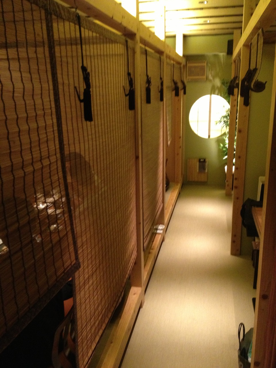 You eat in private booths to the left and right of the corridor ... — at Osaka.