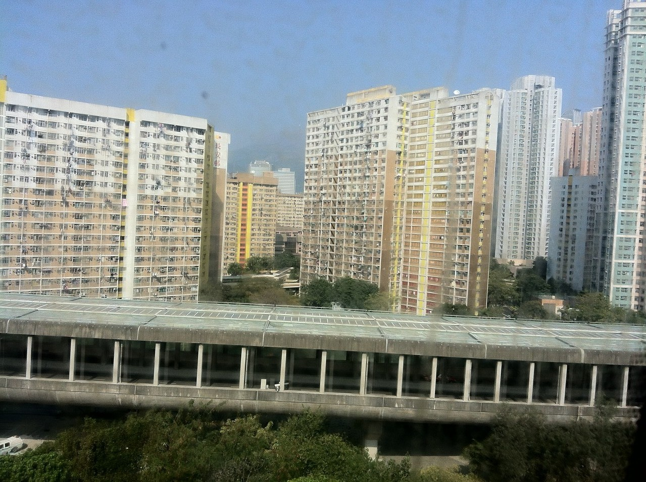 The train whizzes us by countless high rises - looks like it's quite tough to live there ... — in Hong Kong, Hong Kong.