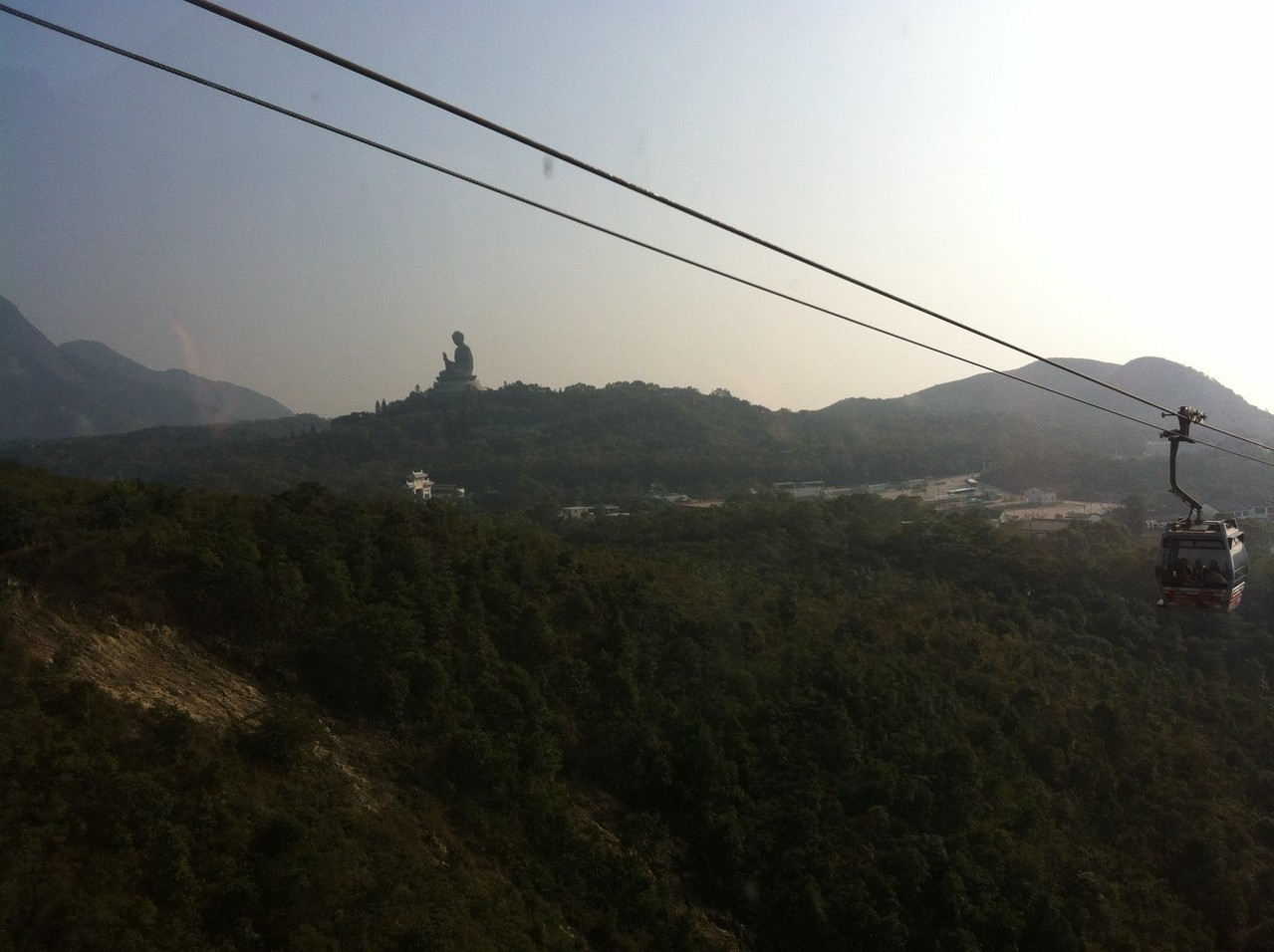 Finally we catch sight of our destination ... the huge buddha built on top of the hill — at Ngong Ping Cable Car.