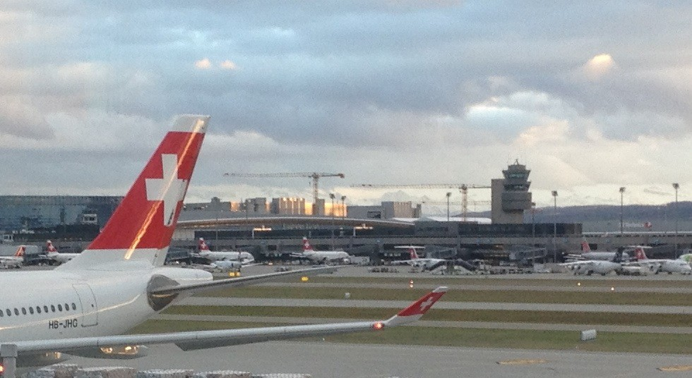 Last glimpse of Switzerland and the Alps in the background .. — at Zürich Airport.