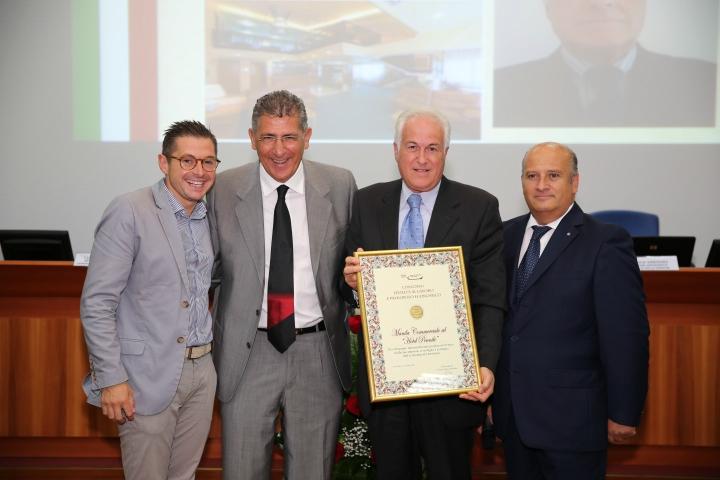 Croce premiato dal presidente della Camera di Commercio di Ascoli Gino Sabatini