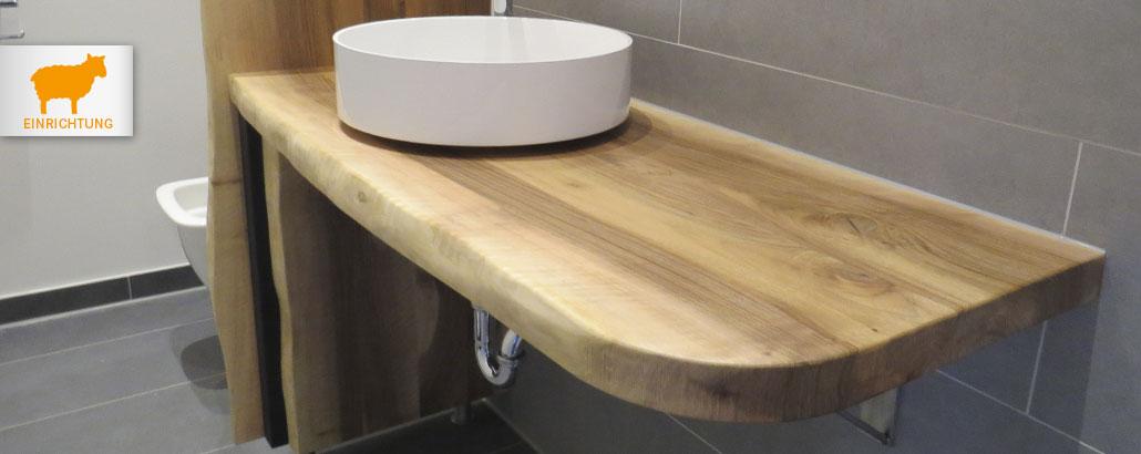 Einrichtung – Waschtisch aus Nussbaum, Platte und Seitenteil mit Waldkante und abgerundeten Ecke