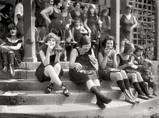 In 1921, early suffragettes often donned a bathing suit and ate pizza in large groups to annoy men...it was a custom at the time..