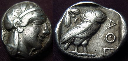Attica, Athens AR Tetradrachm. 465-460 BC. Head of Athena right in crested helmet / Owl standing right, head facing, olive spring and crescent to left.