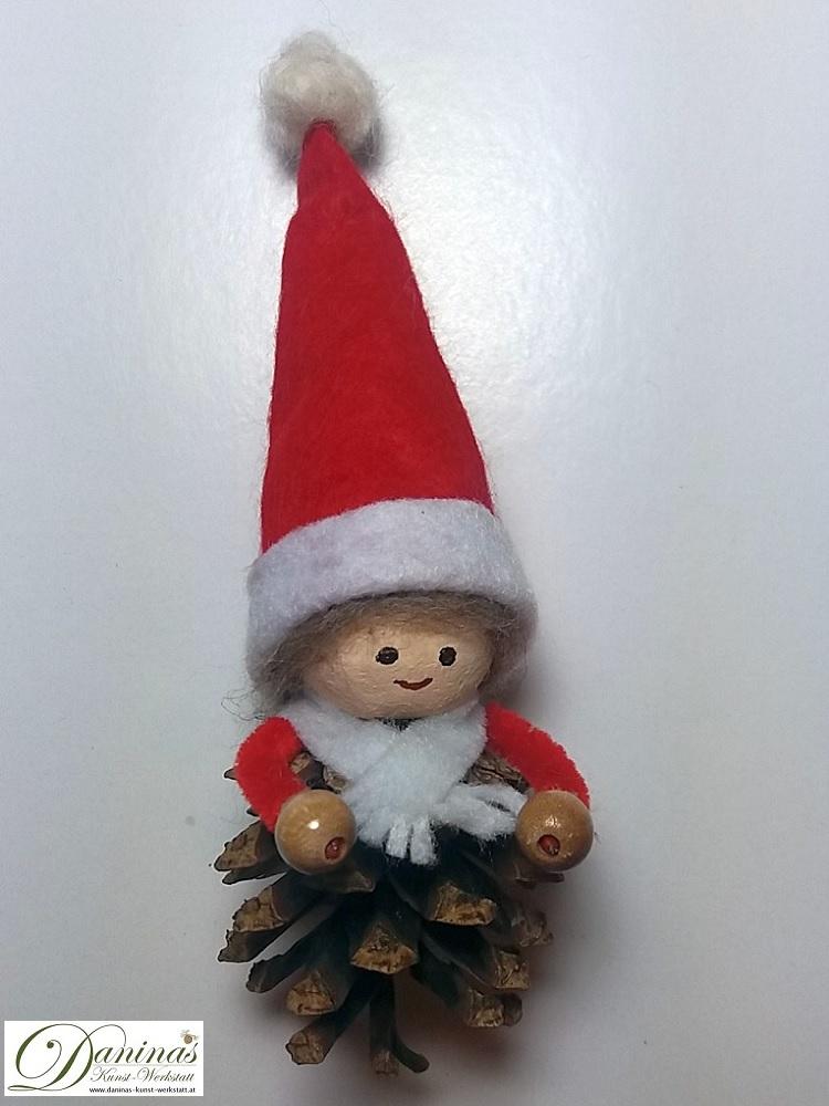 Weihnachtswichtel Bringfreud. Handgemachte Märchenfigur aus Kiefernzapfen, mit braunen Haaren aus Wolle, rot-weißer Zipfelmütze  und weißem Schal aus Filz