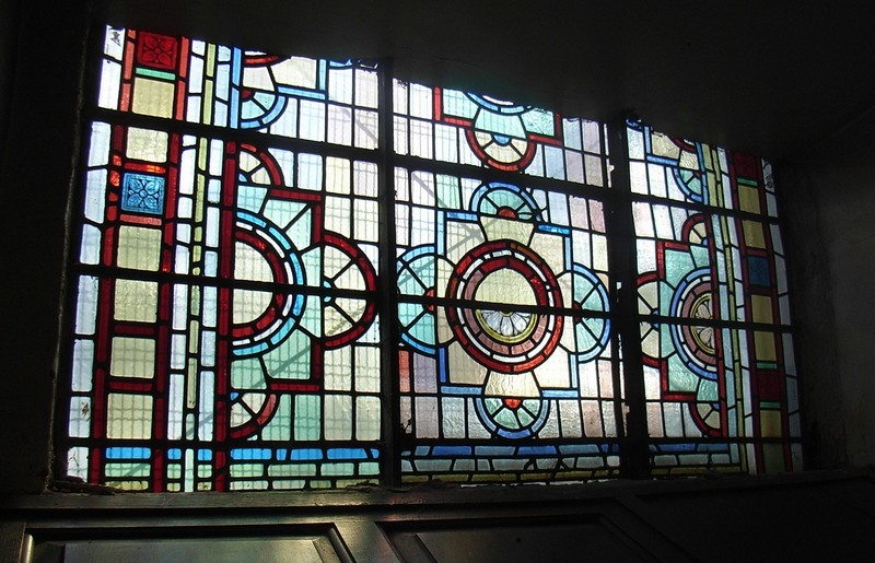 A small amount of Victorian glass was saved from the c1960's replacement with plain glass windows, which were put in in the spirit of the 18th century. This window is in the sacristy as the back of the church.