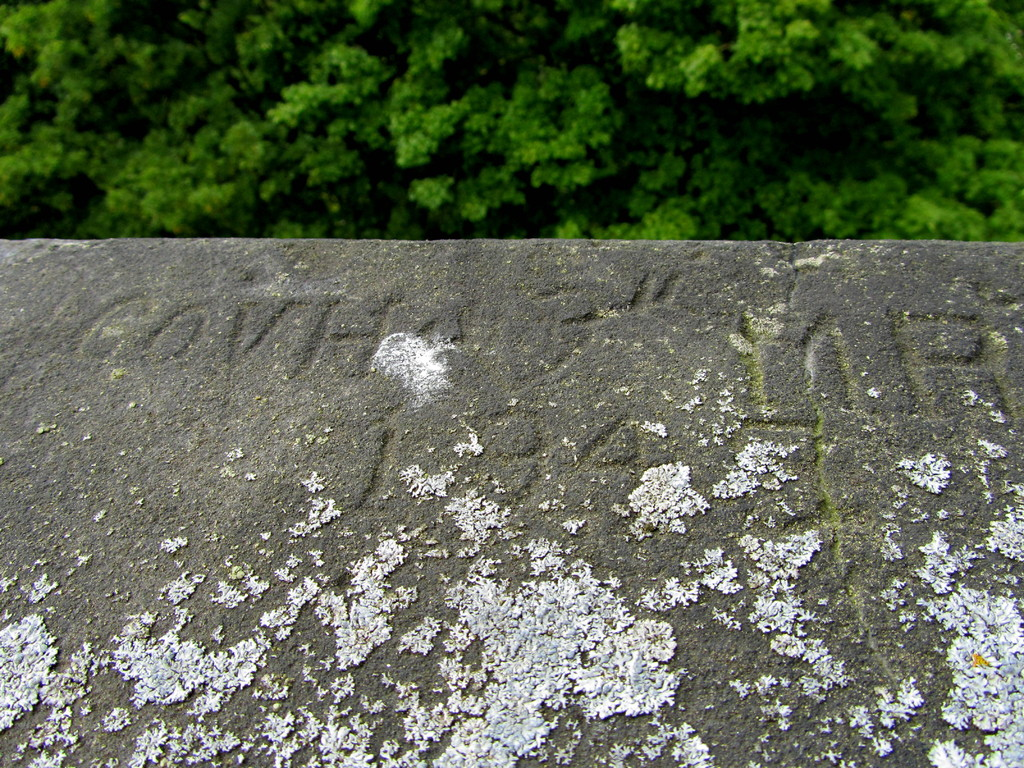 Graffiti on the tower parapet - the tower was used during World War 2 as a look-out post.