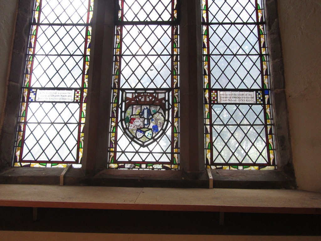 North aisle window (east end) in memory of the last schoolmaster of Yardley Grammar School, William Surtherns