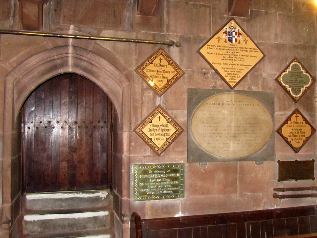 Memorials by the north-west door