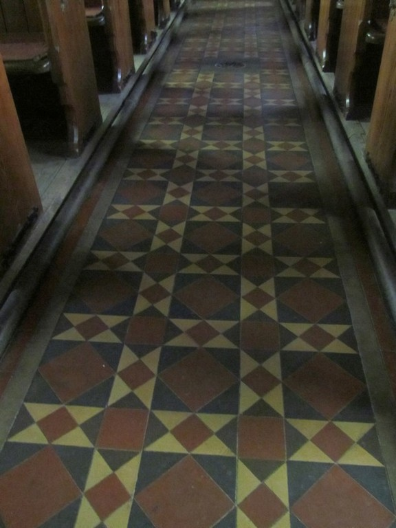 Victorian encaustic tiles in the aisle