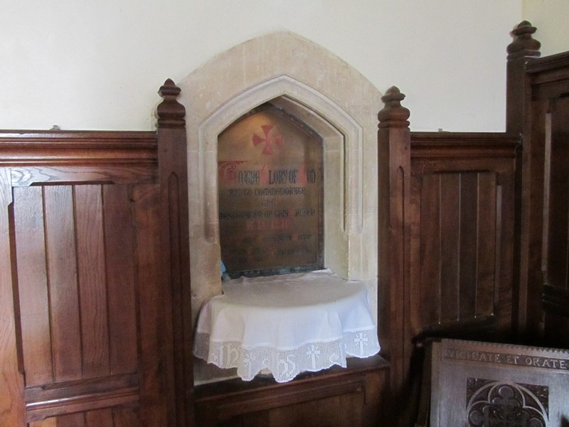 Chancel - credence table with tablet recording the 1870 restoration