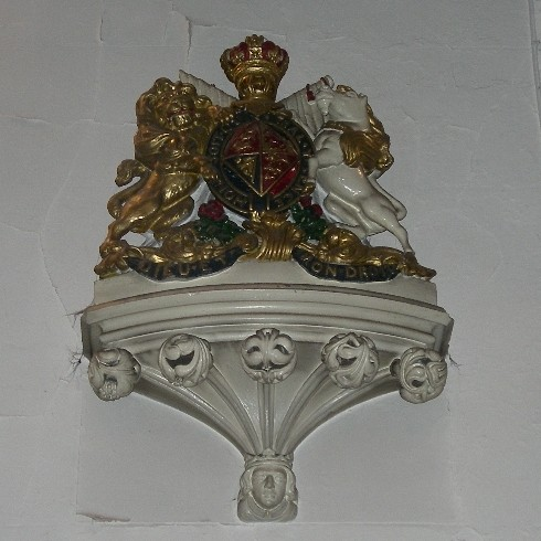 Although the church opened in 1835, two years before the death of King William IV, the royal arms are the standard royal arms used from the time of Queen Victoria, whom they presumably represent, as a lozenge denoted a woman's coat of arms.