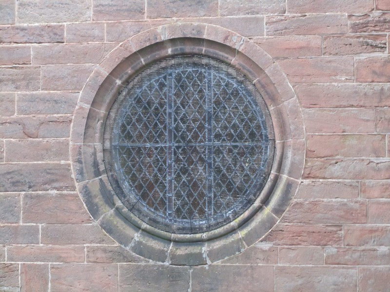 Bull's-eye window in the north side of the tower