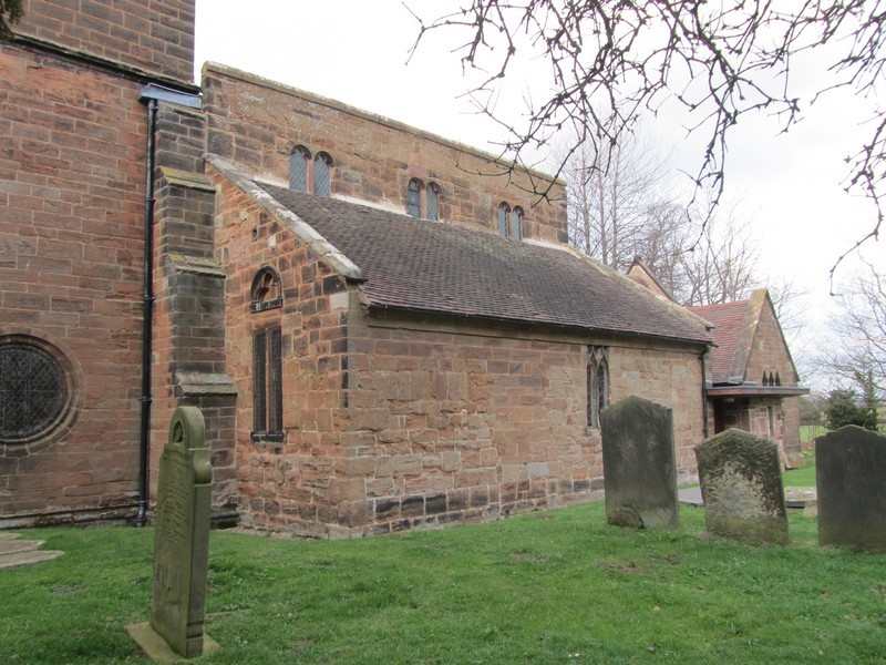 The 13th-century north aisle. Alterations were made to the windows in the 15th century when the clerestory was built. Evidence of an old doorway can be seen in the north wall.