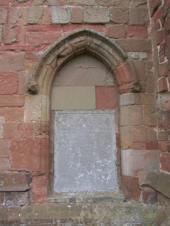 Walled-up doorway in the north wall of the nave