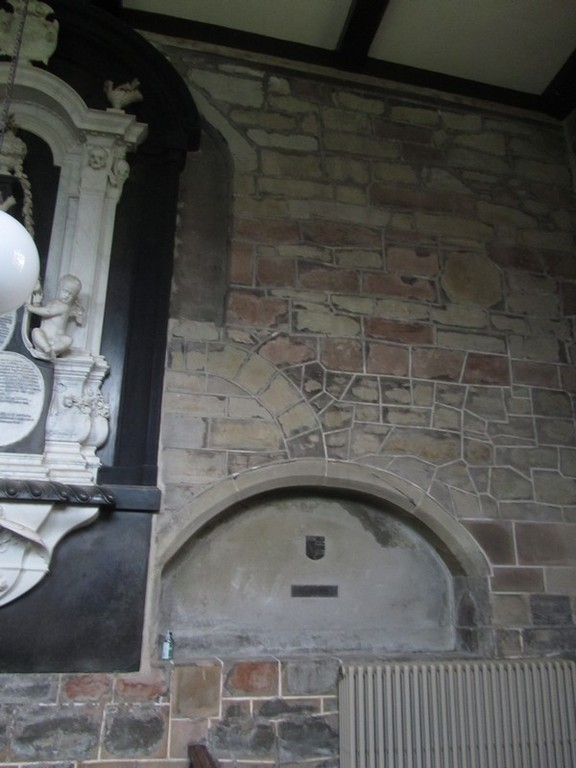 Blocked 12th-century window on the north wall of the chancel