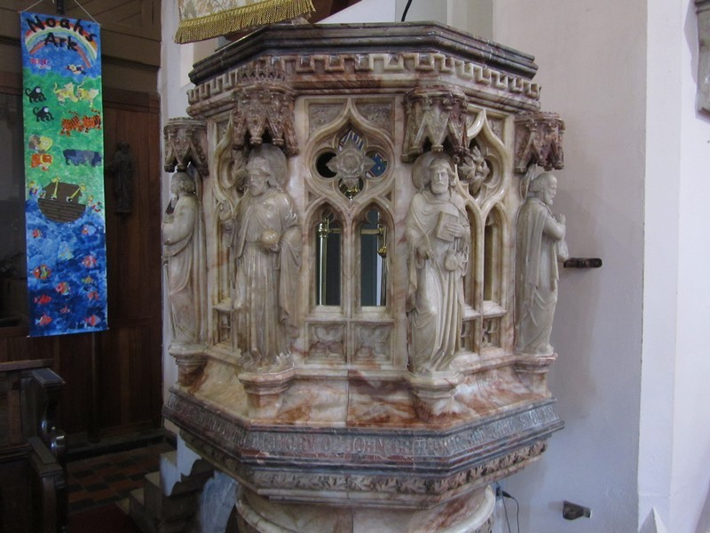 The Pulpit given in memory of J Chatwin and J Stokes 1885. Figures represent Jesus, St Peter and the Evangelists.