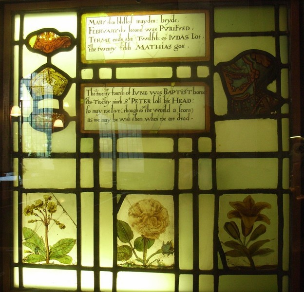 Part of a series of 17th-century glass depicts flowers and fruit and has a rhymed calendar giving the feast days of the Church's year.