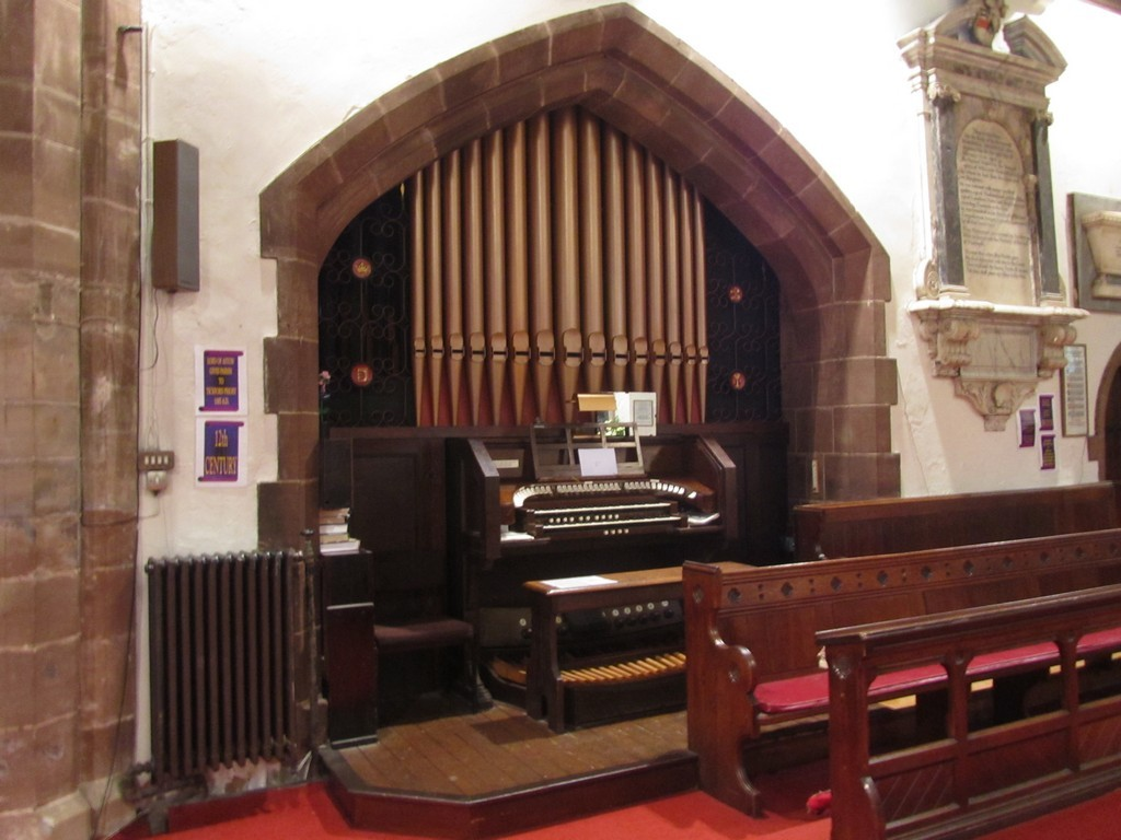 The organ console is set chancel in the arcade of the north-east vestry.