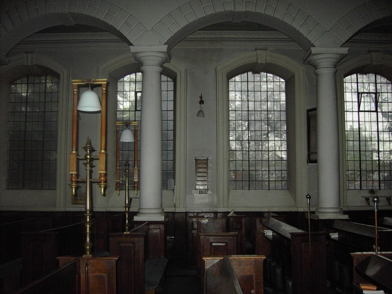The 18th-century windows are not in line with the medieval pillars.