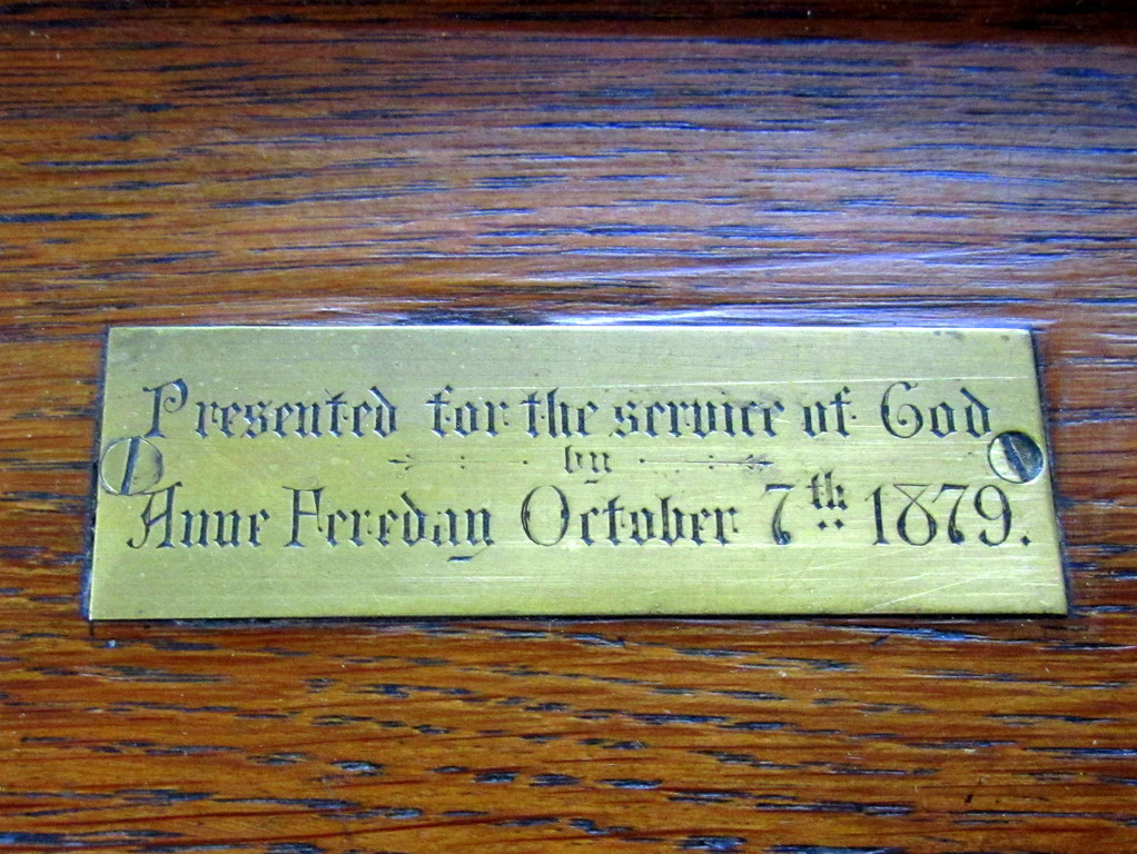 Reading desk inscription dated 1879, the date of the building of this church
