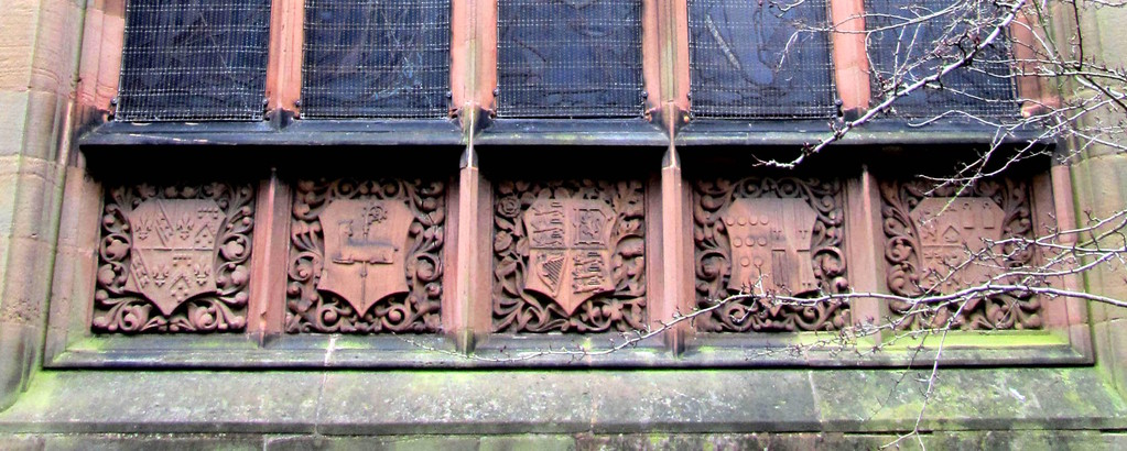 Coats of arms below the east window