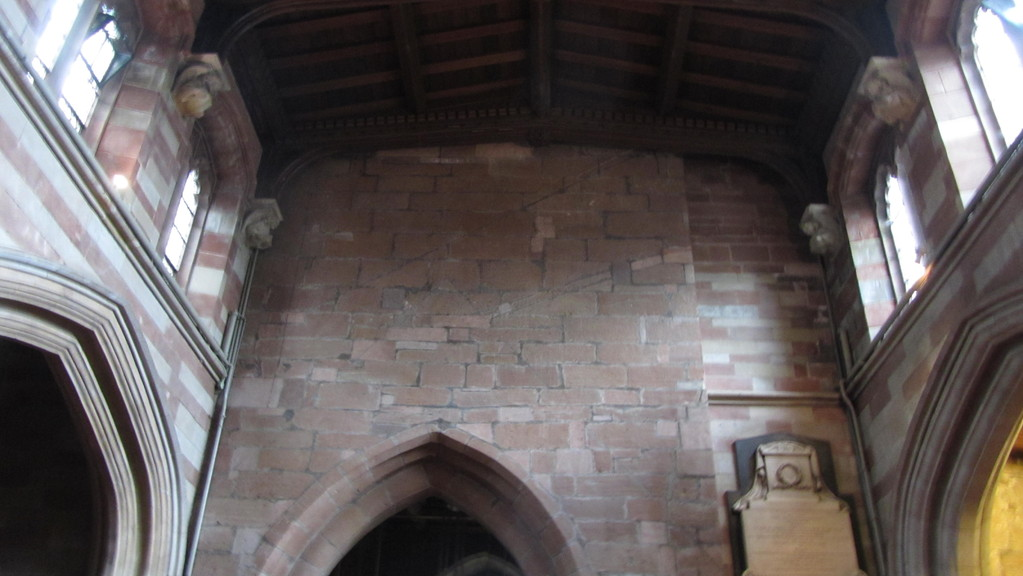 East wall of the tower - Note the marks on the wall of previous nave roofs.