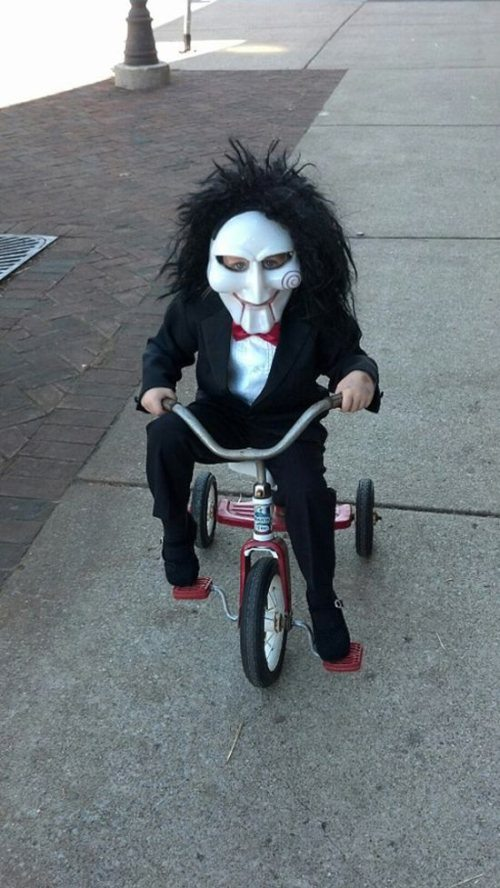 Photo by: https://www.askideas.com/baby-in-halloween-costume-riding-tricycle-funny-image/
