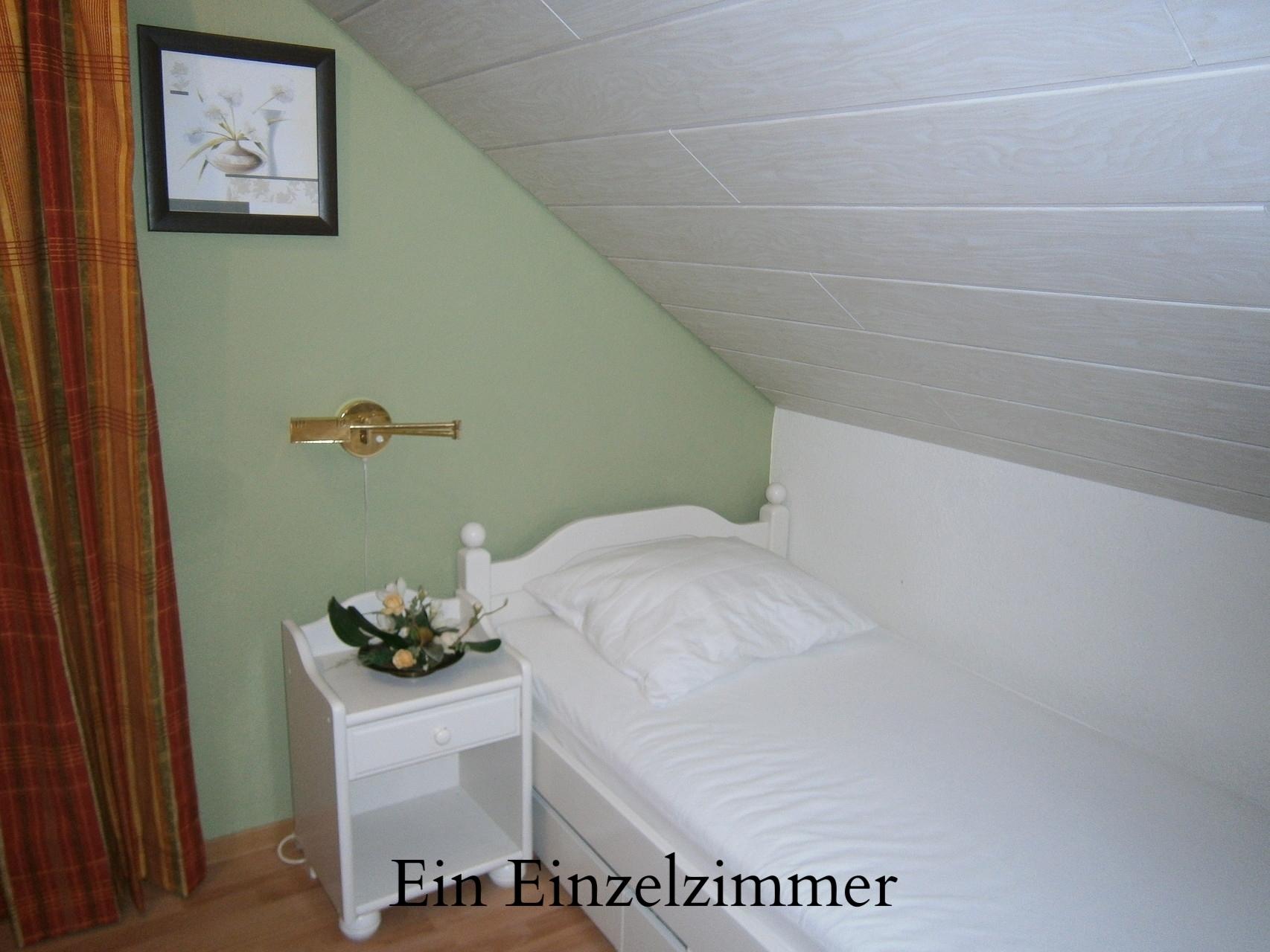 Eenpersoons slaapkamer boven