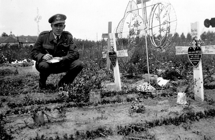 Flight Lieutenant Noel Archer of the MRES noting details of aircrew graves at a civilian burial ground in France.     (RAF Museum)