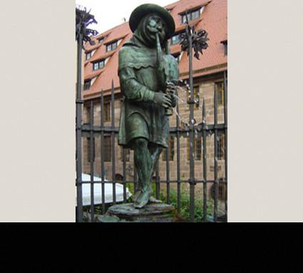 Der Nürnberger Dudelsackpfeifer, 1880; Standort: Nürnberg, Unschlittplatz; Bildhauer: Friedrich Wanderer; Guß: Cristoph Lenz