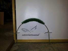 Arco para pinchar en jardín.