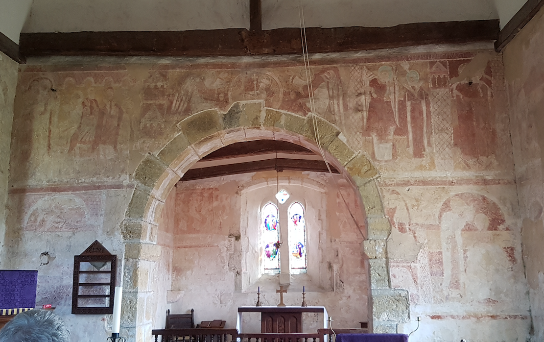 West side of chancel arch shows an Annunciation