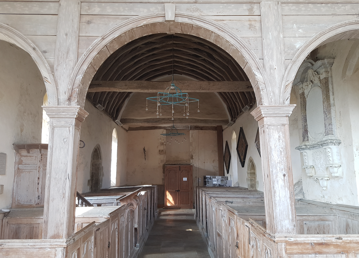 18th cent. pinewood pews fill the nave.
