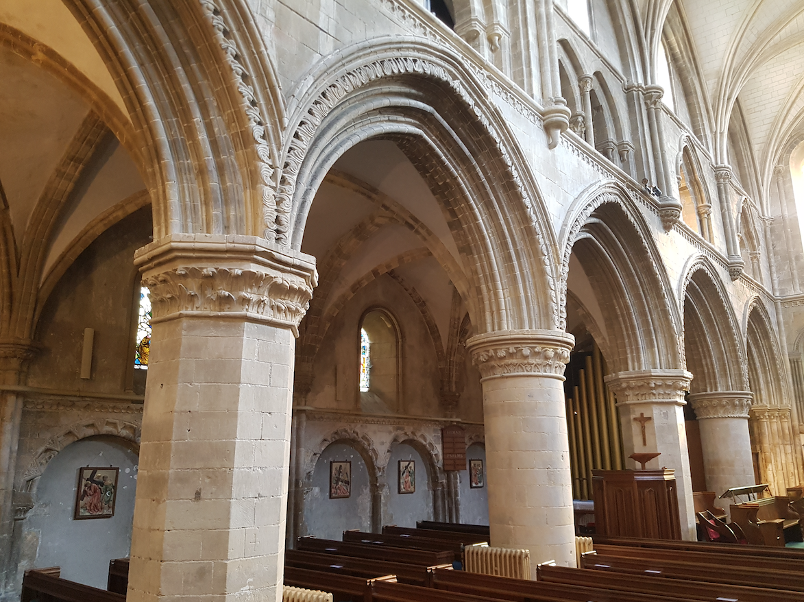 North arcade piers are alternately round and octagonal in Norman style