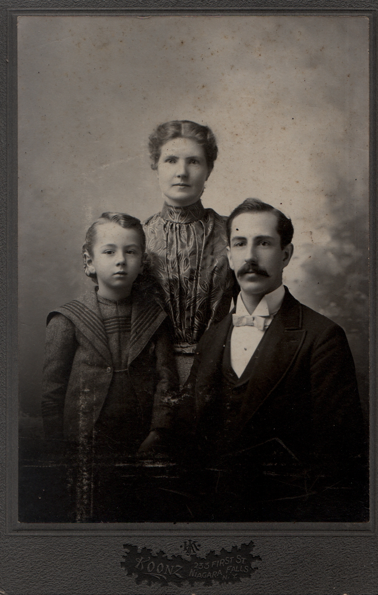 Alberta Hodson, her husband Herbert Frederick Polhill and son. circa 1898. Reverse ' for Gus with love.'