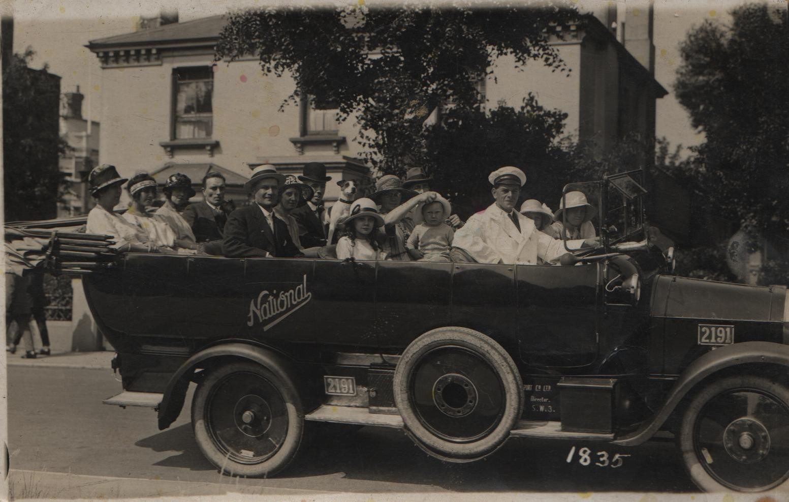 circa 1923-4 Clacton-on-Sea Joan and Dorothy are next to the driver. David is on his other's lap having hat brim pulled up by K.M.Lilley. Hat and forehead of J G Lilley behind.