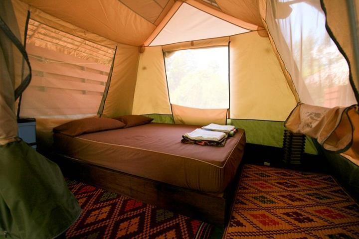 sleeping room with double mosquito nets