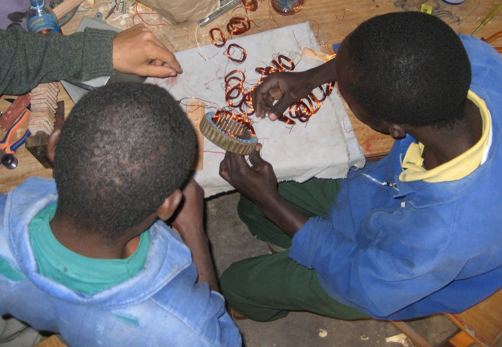 students working on a part of a windmill