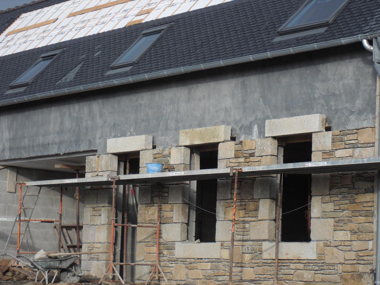 Doublage de la façade en pierres ...