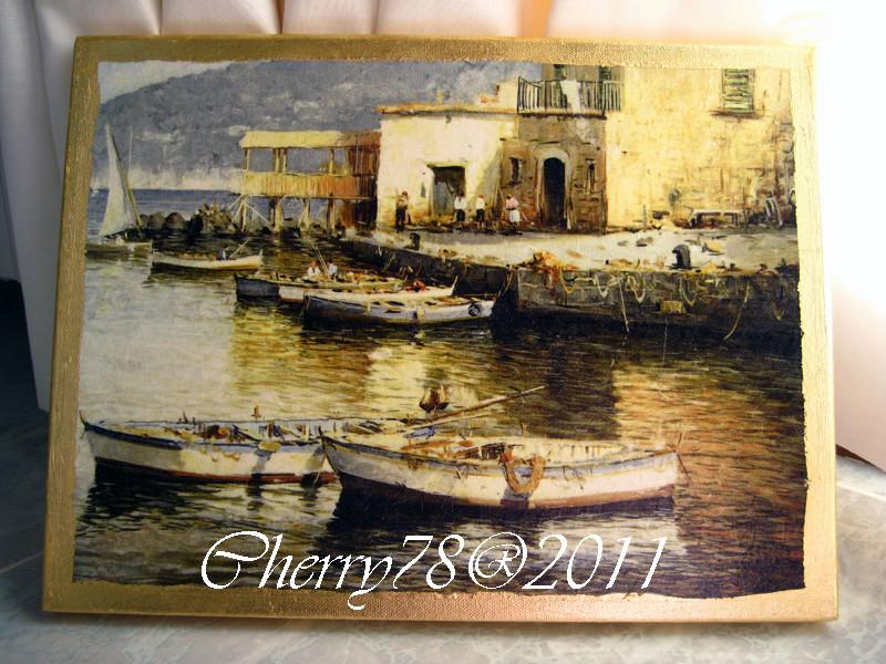 Tela 30x45, scorcio con barche, bordo foglia oro, finale spray lucido
