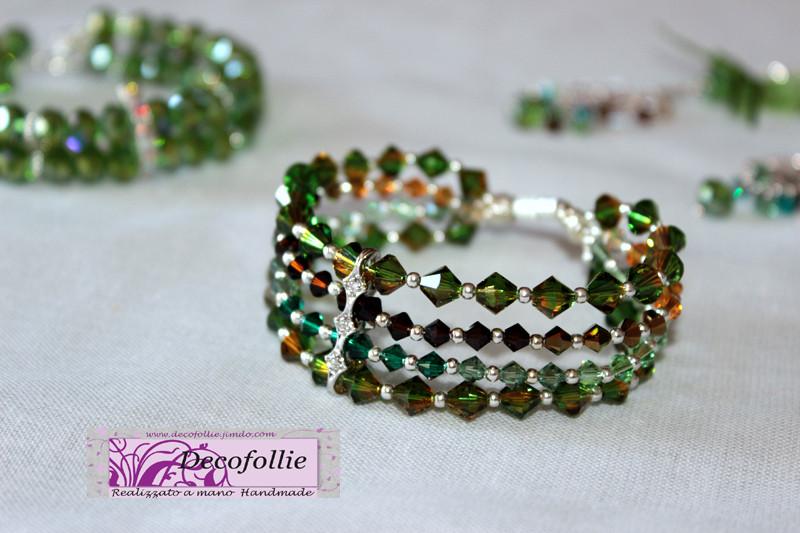 Art. 287 E Bracciale a 4 fili con swarosky verdi, marroni, arancio e separatore argento con brillantini