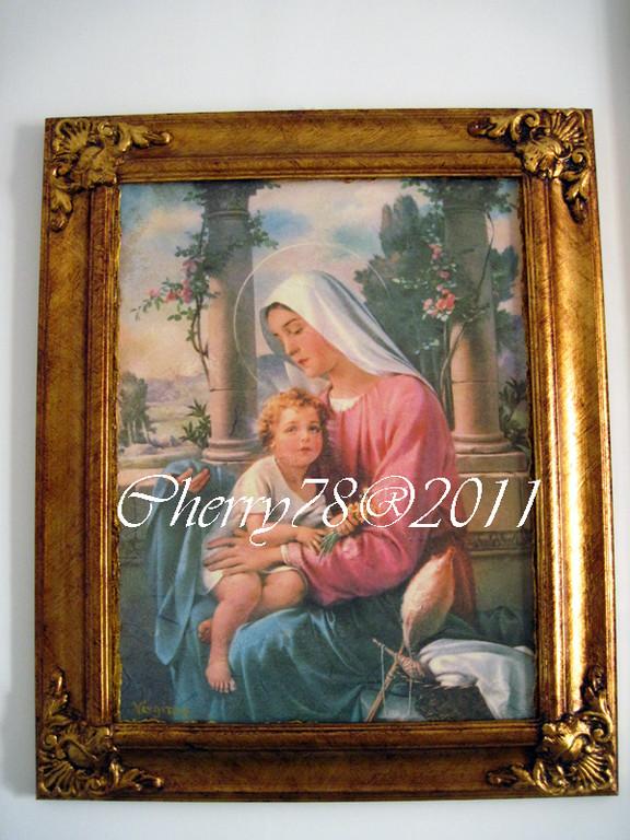 Tela 30x45, madonna con bambino , cornice di legno intagliata a mano, fregi negli angoli, foglia oro anticata a bitume