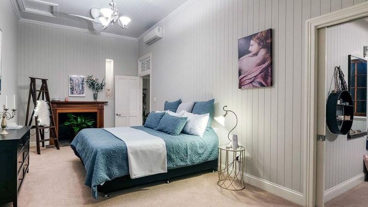 BEDROOM RENOVATIONS: The master bedroom showcases the classic charm of the home, with panelling and high, ornate ceilings. Character features in the home include pressed metal ceilings, polished hardwood floors and wide curved archways.