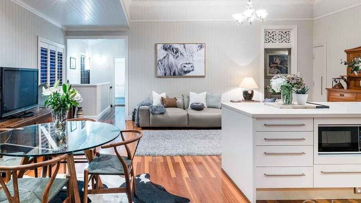 KITCHEN RENO: The largest portion of the renovation happened in 2004: the kitchen was converted into the main bedroom, and a new kitchen was created as part of a back extension. A large back deck was also added onto the property.