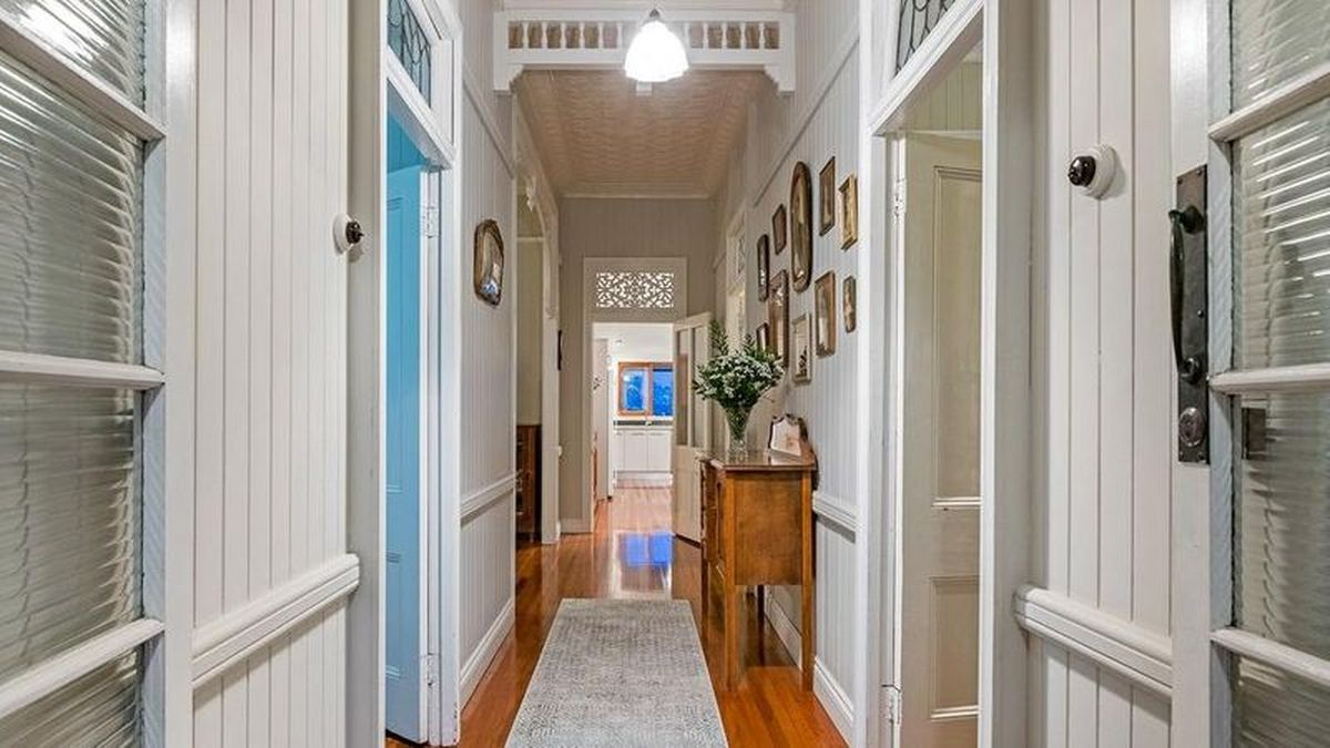AFTER: Now, the four bedroom home is a perfect blend of old-world character charm and modern updates.
