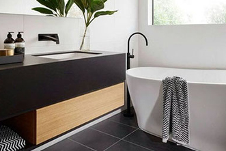 Luxury bathroom with beautiful tiling renovated by Sydney Budget Kitchens