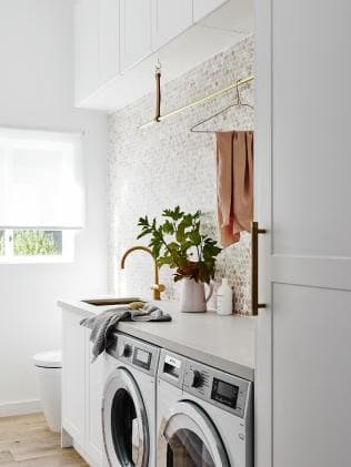 Laundry renovation with the pink penny-round tiled splashback